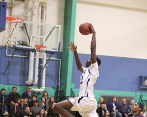 Jacquil Taylor (14 points) gets set to dunk