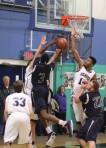 Alonzo Jackson (18 points) shoots in traffic