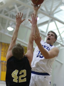 Julian Dunn (22 points) shoots over Bryce Fey