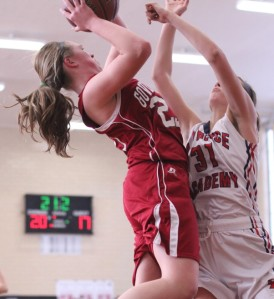 Courtney Cashman (17 points) tries to shoot over Gabrielle Reuter (16 points)