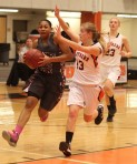 Michayla Woodward guards Deidra Newson (16 points)