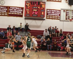 McKenna Kilian (15 points) starts her drive for the tying basket in regulation