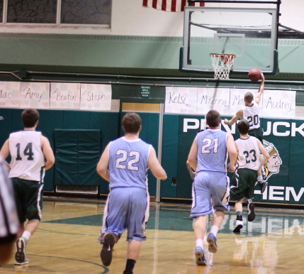 Jeff Porter (13 points) gets one of many Pentucket breakaways