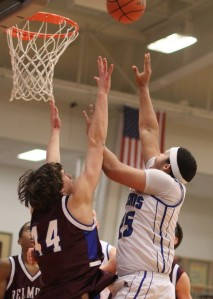 Devan Harris shoots over Justin Wagner