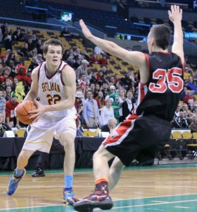 Rory Donovan (15 points) looks for an opening