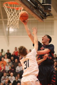 Nick Cambio (19 points) shoots over Mike Bisson