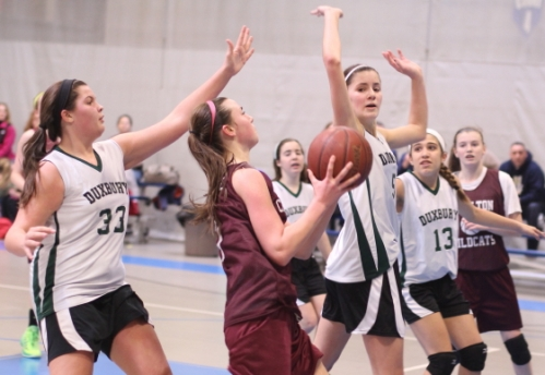 Julia Dandridge of Charlton gets in among the Duxbury shot blockers
