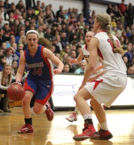 Jackie Luckhardt (10 points) drives on Haley Driscoll