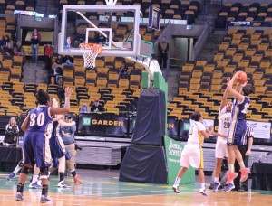 Alana Gilmer (18 points) takes a last-minute shot defended by Kayla Carter and Sharell Sanders