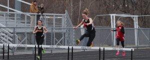 Jill Calvani takes 400 hurdles