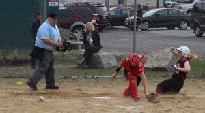 Amy Sullivan scores as the ball gets by catcher Amanda Schell