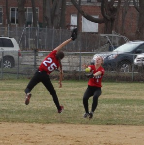 Meagan Aponas catches a fly just beyond the reach of Maddie Napoli