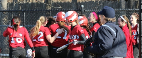 Zoe Fitzgerald (#21) gets cheers from her teammates after circling the bases in the sixth inning.