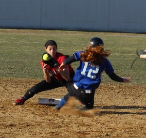 Maddie Napoli readies the tag for Jen Nutter