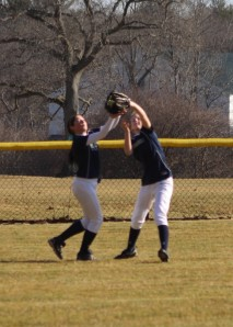 Hannah Stasiuk and Maria Garbarino get together on a fly ball