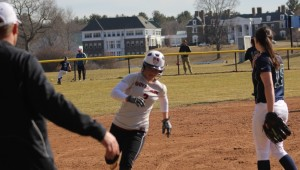 Coach Scott Kingsbury sends Sarah Dupere home as the ball reaches the fence