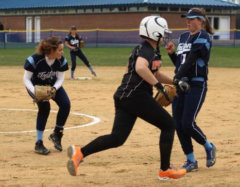 Triton pitcher Mara Spears sets to throw to first.