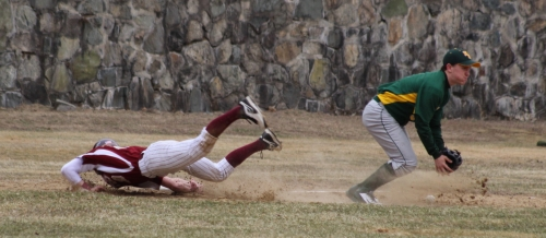 Chase Carpenter dives into third as the ball drops in front of North Reading third baseman Tom Day