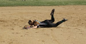 Shortstop Kassidy Kennefick dives for a grounder