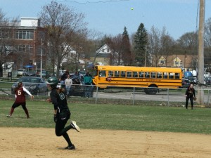 Tyler Feeney circles the bases as leftfielder Amy Sullivan throws in to Meghan Stanton