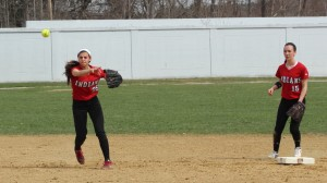 Maddie Napoli throws to first
