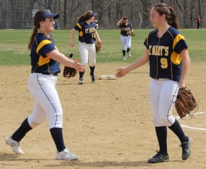 Pitcher Mia Nowicki gets congratulated by teammate Katie Terban