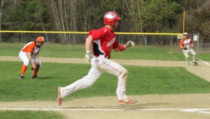 Ben Cullen gets the first Amesbury run on an infield out