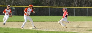 Ben Cullen tries for third base.