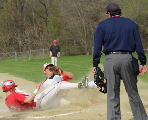 Pat Scanlon scores the second Amesbury run on a close play at the plate.