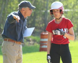 AHS coach Chris Perry instructs Meg Aponas