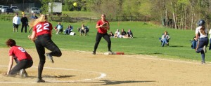 Third baseman Autumn Kligerman throws to first baseman Zoe Fitzgerald
