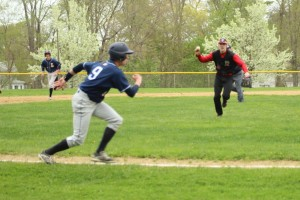 Ryan Battaglia caught between third and home by AHS second baseman Jack Aponas