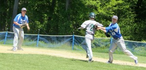 Duncan Hough tags out Brian Raimo for the final out of the game
