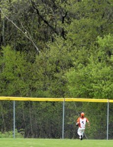 Leftfielder Jake Long eyes the home run ball (upper left)