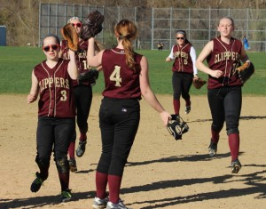 Pitcher Vicki Allman (#4) congratulates her teammates after the game