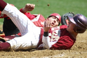 Ryan Furlong and catcher Mac Short collide at the plate