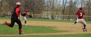 Travis Wile flips the ball to pitcher James Nutter covering first