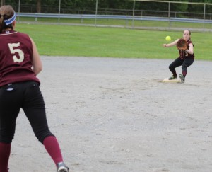 Molly Kelley takes a throw at second