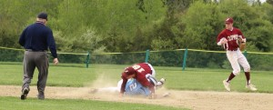 Nick Desrocher slides into second baseman Matt Short