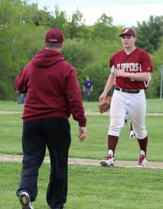 Coach Steve Malenfant congratulates reliever Will Cataldo