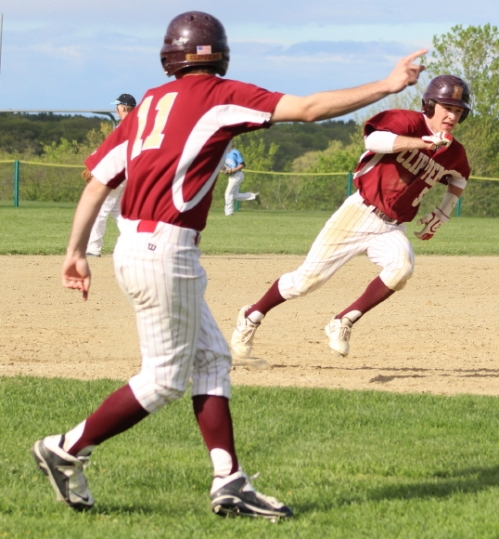 Jeremy Grabowski (#11) points baserunner Caleb Stott to home