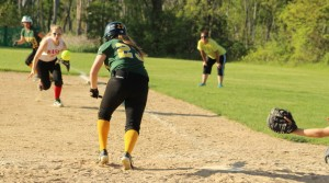 Emma Santosuosso tries to bunt as first baseman Kylie Currier charges
