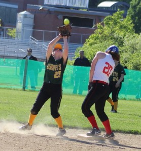 Tarah Reilly takes in a popup as baserunner Maddie Kelly ducks out of the way