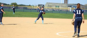 Triton shortstop Rylie Culverwell throws to first