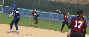 Second baseman Emily Faulds makes a backhand stab