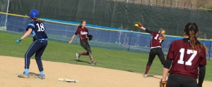 Second baseman Emily Faulds makes a backhand stab