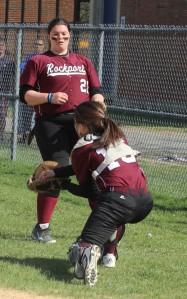 Catcher Mollie Watson catches a foul popup