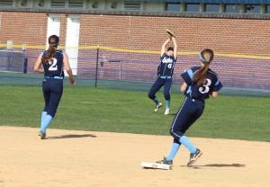 Casey Ross battles the sun to catch a fly ball in center.