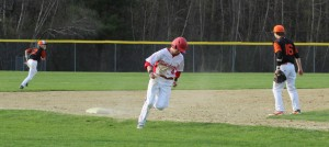 Mike Swanson heads for home with the seventh Sachems run