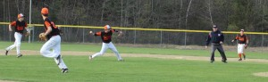 Third baseman Chris Grady throws to first